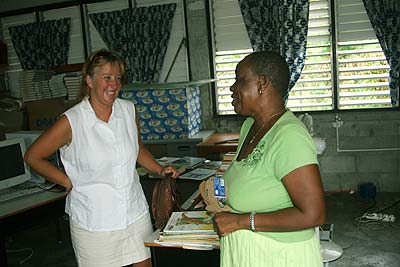 Kim and Mrs Green, Principal of Dublanc Primary school share a joke in the school library.
