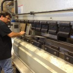 Todd at RS Automation tweeking the bends in the chainplates in 30 ton press