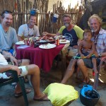 Crew from Sea Angel and Anahata enjoying lunch prepared by a local Kuna Family. Cost $5 per person grilled lobster, rice and beans plus salad. We supplied the beers and butter.